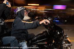 Riding down Main Street during Daytona Beach Bike Week, FL, USA. Sunday March 8, 2015.  Photography ©2015 Michael Lichter.