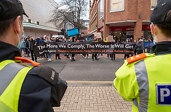 © Licensed to London News Pictures; 12/12/2020; Bristol, UK. Police watch as an anti-vaccine and anti Covid restrictions protest takes place in Bristol city centre during the Covid-19 coronavirus pandemic in England, as the UK has become the first country in the world to approve the Pfizer/BioNTech vaccine for widespread use to combat Covid-19. Bristol is in Tier 3 restrictions. The organiser has said the march is against lockdowns, tiers, restrictions, isolations, masks and vaccines. Photo credit: Simon Chapman/LNP.