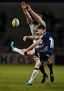Sale Sharks Will Clift clears the ball as  Saracens second-row George Kruis tries to block during the Aviva Premiership match Sale Sharks -V- Saracens at The AJ Bell Stadium, Salford, Greater Manchester, England on Friday, February 16, 2018. (Steve Flynn/Image of Sport)