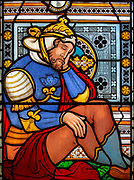 Victorian 19th century stained glass window, Lawshall church, Suffolk, England, UK by Horwood Bros - Sleeping Roman soldier