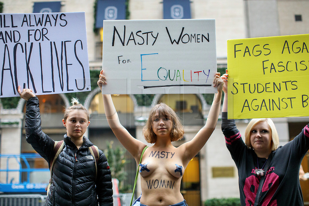 © Licensed to London News Pictures. 09/11/2016. New York CIty, USA. Anti-Trump campaigners protest outside Trump Tower in New York City, on Wednesday, 9 November 2016 following the presidential election won by Donald Trump. Photo credit: Tolga Akmen/LNP