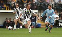 Photo: Leigh Quinnell.<br /> Notts County v Bury. Coca Cola League 2. 06/05/2006.<br /> Notts County captain Julien Baudet gets the ball away from Burys Matthew Tipton.