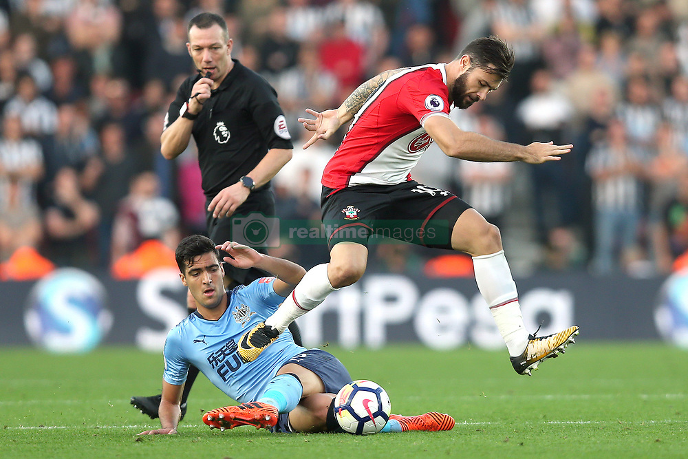 15 October 2017 - Premier League Football - Southampton v Newcastle United - Charlie Austin of Southampton leaps over Mikel Merino of Newcastle - Photo: Charlotte Wilson / Offside