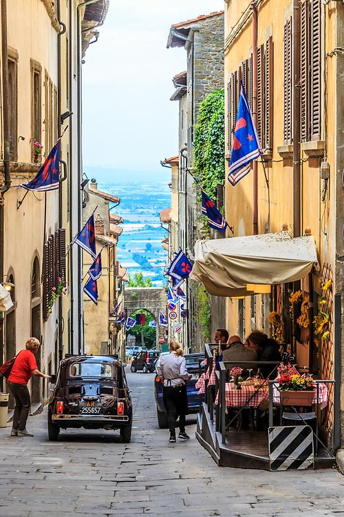 An street in Cortona, Italy. The streets of Cortona are steep and  narrow.