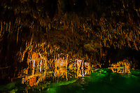 Limestone caves containing stalactites and stalagmites and cenotes connecting to an underground river, Aktun Chen Natural Park, Aktun, Riviera Maya, Mexico.