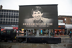 © Licensed to London News Pictures. 01/02/2017. Watford, UK. A giant screen erected on the high street for fans to view the funeral of former England football team manager Graham Taylor at St Mary's Church in Watford, Hertfordshire. The former England, Watford and Aston Villa manager,  who later went on to be chairman of Watford Football Club, died at the age of 72 from a suspected heart attack. Photo credit: Ben Cawthra/LNP