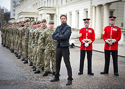 © Licensed to London News Pictures. 04/04/2013. London, UK Hollywood actor Gerard Butler with soldiers from F Company the Scots Guards.  Butler met the soldiers at Wellington Barracks in Central London ahead of a special preview screening of Hollywood movie Olympus Has Fallen, released 17th April 2013. ..The actors spent time talking to the soldiers prior to the troops watching a special preview of the film in the barracks. Photo credit : Alison Baskerville/LNP