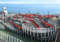 April 25, 2017 - inconnu - Cruise passengers booking with a new ship will be able to race around on deck – on a Ferrari-branded karting race track.Norwegian Cruise Line's new Norwegian Joy, a ship the cruise line is building for its market in China, will be the first in the world to feature a racetrack.It is in partnership with Scuderia Ferrari Watches .Set to be one of the ship's key attractions, the racetrack will allow up to ten drivers to compete against each other in electric go-carts. The thrilling experience with culminate in a photo finish which the winner can then share with friends and family.Norwegian Cruise Line says The Haven and Concierge class passengers will ''enjoy a number of complimentary rides as part of the amenities and benefits of their suites and staterooms.'' Once drivers complete on the course, they will be free to browse a nearby retail store which features a selection of Scuderia Ferrari Watches.The 3,850-passenger Joy will start sailing from Shanghai on June 27 and also homeport in Tianjin. Other stand-out features will include an open-air laser tag course, hovercraft bumper cars, multi-story water slides and the cruise line's largest-ever upscale shopping venue. # PISTE DE KARTING SUR UN PAQUEBOT (Credit Image: © Visual via ZUMA Press)