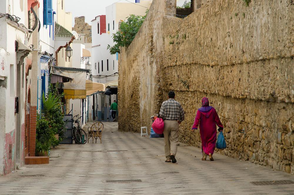People walk through medina in Asilah, North Morocco
