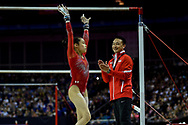 Victoria Nguyen of the United States of America (USA) after performing on the uneven bars on her way to winning the woman's Silver Medal is applauded by her coach during the iPro Sport World Cup of Gymnastics 2017 at the O2 Arena, London, United Kingdom on 8 April 2017. Photo by Martin Cole.