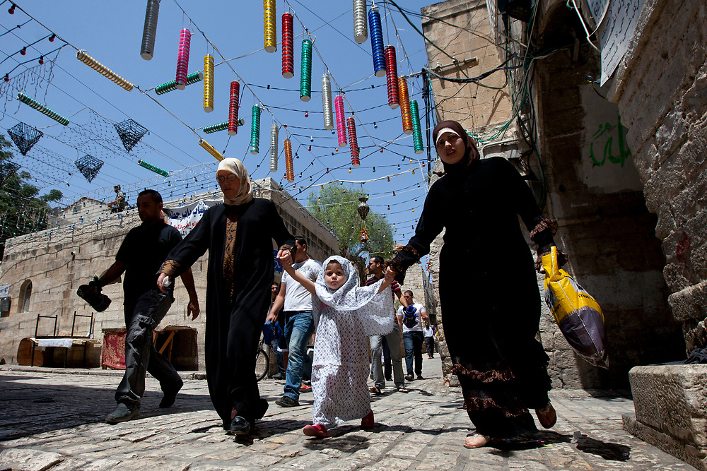 Muslim worshippers make their way through Jerusalem's Old City to attend prayers at the Al Aqsa Mosque on the second Friday of the Muslim holy month of Ramadan, August 20, 2010.