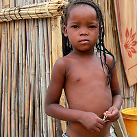 Africa, Botswana, Okavango Delta. Delta girl growing up in a village in the Okavango.