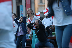 © Licensed to London News Pictures. 07/07/2021. London, UK. England fans react. England fans gather at the Fan Zone in Trafalgar Square, central London, for the Euro 2020 semi final between England and Denmark. England are attempting to reach their first final since 1966. Photo credit: Ben Cawthra/LNP