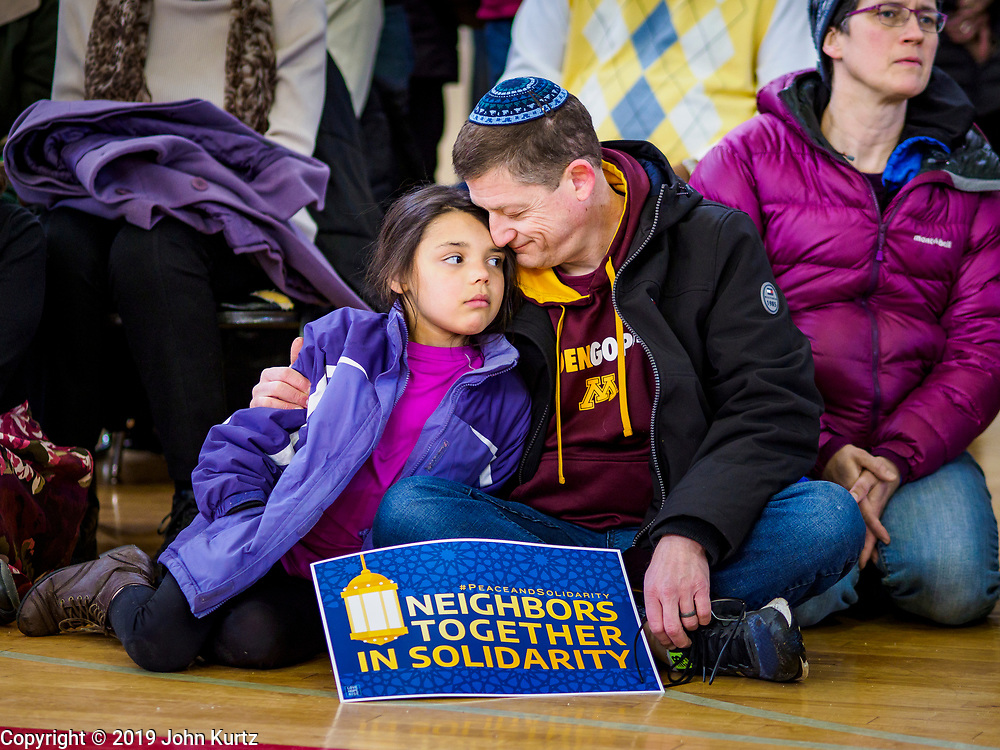16 MARCH 2019 - BLOOMINGTON, MINNESOTA, USA: A man and his daughter at Dar al Farooq Center in Bloomington. An interdenominational crowd of about 1,000 people came to the center to protest white supremacy and religious intolerance and to support Muslims in New Zealand who were massacred by a white supremacist Friday. The Twin Cities has a large Muslim community following decades of Somali immigration to Minnesota. There are about 45,000 people of Somali descent in the Twin Cities.    PHOTO BY JACK KURTZ