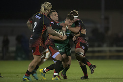 November 3, 2018 - Galway, Ireland - Tom Farrell of Connacht tackled by Jason Tovey and Richard Hibbard of Dragons during the Guinness PRO14 match between Connacht Rugby and Dragons at the Sportsground in Galway, Ireland on November 3, 2018  (Credit Image: © Andrew Surma/NurPhoto via ZUMA Press)