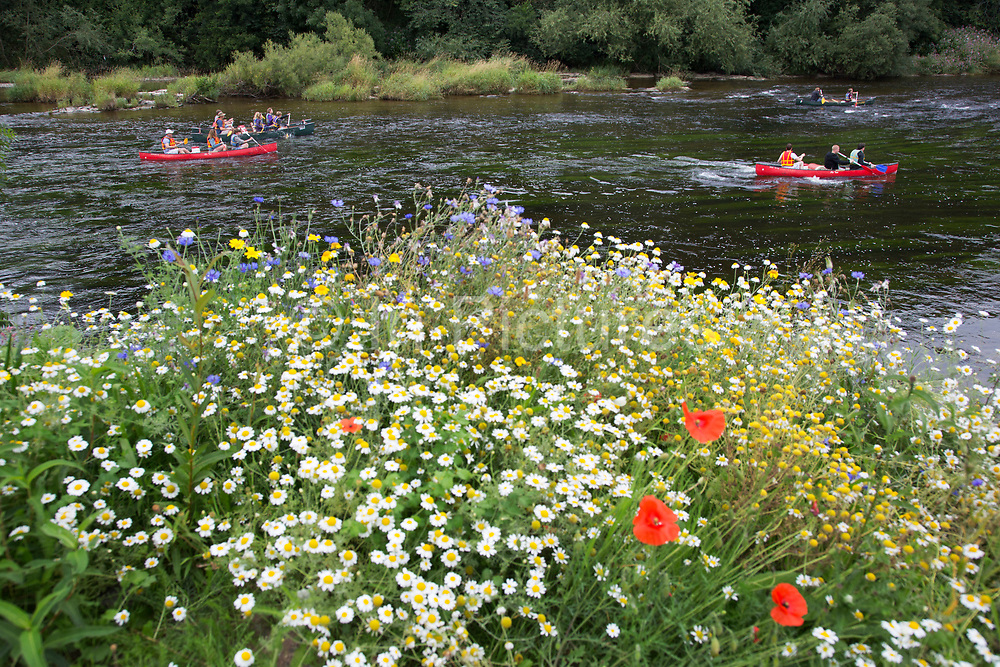 """Canoeing and kayaking along the River Wye at Hay-on-Wye or Y Gelli Gandryll in Welsh, known as """"the town of books"""", is a small town in Powys, Wales famous for it's many second hand and specialist bookshops, although the number has declined sharply in recent years, many becoming general antique shops and similar."""