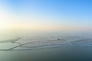 Nederland, Flevoland, Houtribdijk, 28-10-2016; Marker Wadden, eerste fase van aanleg Marker Wadden, het hoofdeiland. Doel van het project van Natuurmonumenten en Rijkswaterstaat is herstel van de ecologie in het gebied, met name de kwaliteit van bodem en water. Tussen de verschillende dammen en dijken is ijs te zien.<br /> Marker Wadden first phase of the construction, the main island. The aim of the project is to restore the ecology in the area, in particular the quality of soil and water. Ice between the various dams and dikes due to the winter weather.<br /> luchtfoto (toeslag op standard tarieven);<br /> aerial photo (additional fee required);<br /> copyright foto/photo Siebe Swart