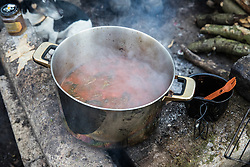 Wendover, UK. 10 January, 2020. A pot of soup is prepared in the Wendover Active Resistance Camp. Stop HS2 activists from around the UK established the camp in woodland outside Wendover on the proposed route for HS2 through the Chilterns AONB in response to requests for assistance from members of the local community opposed to the high speed rail link. The impact on the immediate area is expected to be even worse than initially expected, with not only two 500m viaducts and a 1km embankment to be constructed but also a Bentonite factory and 240-bed accommodation block.