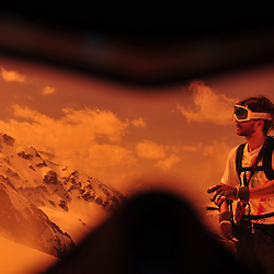 Nicholas Marchionini  studying the snow conditions in light of the upcoming attempt of a new unskied first descent line in the North Face of the Pic du Midi de Bigorre.
