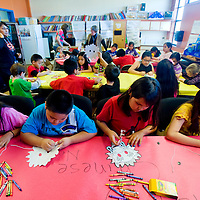 021213      Brian Leddy<br /> Student in the Jefferson Elementary after school program makes masks as part of a Chinese New Year celebration Tuesday. The school has over 100 student in the program, one of the largest in the district.