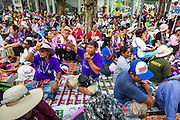 16 MAY 2014 - BANGKOK, THAILAND: PDRC protestors sit in the street in front of the Thai parliament building in Bangkok. Thousands of protestors from the People's Democratic Reform Committee (PDRC) surrounded the Thai Parliament complex Saturday to pressure the Thai Senate to select an interim Prime Minister to replace ousted former PM Yingluck Shinawatra. The Senate decided not to appoint an interim PM of their own and announced a meeting with the current interim Prime Minister. The protestors left the parliament complex and threatened to return in larger numbers if the Senate doesn't act. The Senate appointment of an acting PM could plunge Thailand into chaos since there is already an interim Prime Minister from the ruling Pheu Thai party.     PHOTO BY JACK KURTZ
