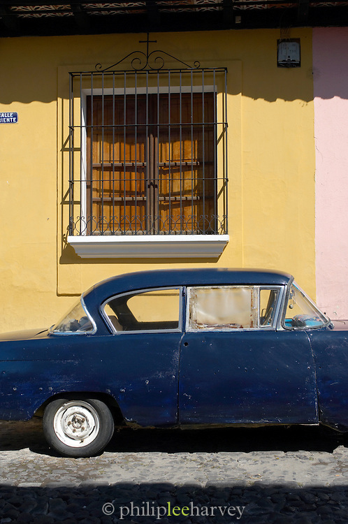 An old car parked in the streets in Antigua, a UNESCO World Heritage Site in Guatemala