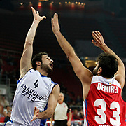 Anadolu Efes's Dogus Balbay (L) during their Turkish Basketball League match Anadolu Efes between Tofas at the Abdi ipekci Arena in Istanbul, Turkey on Tuesday, 24 December, 2013. Photo by TURKPIX