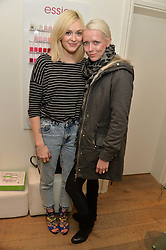FEARNE COTTON and JAKKI JONES wife of Stereophonics' lead singer Kelly Jones at a Valentine's charity event to raise heart awareness and support the charity Arrhythmia Alliance held at Sophie Gass, 4 Ladbroke Grove, London on 13th February 2014.