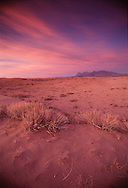 Sunset over the Kelso Dunes and the New York mountain range of the Mojave Scenic area.  The region was preserved along with Death Valley National Park and the Joshua Tree National Monument in the Desert Protection Act of 1990.