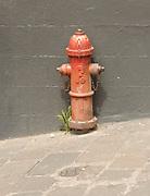A brown fire hydrant in a street in Quito. Quito, Ecuador.