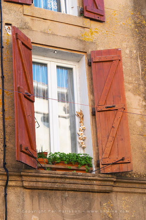 Gruissan village. La Clape. Languedoc. Window. String of garlic hanging in a window to dry. France. Europe.