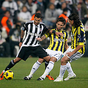 Besiktas's Ricardo QUARESMA (L) and Fenerbahce's Gokhan GONUL (C) during their Turkish Superleague Derby match Besiktas between Fenerbahce at the Inonu Stadium at Dolmabahce in Istanbul Turkey on Sunday, 20 February 2011. Photo by TURKPIX