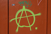 Anarchy symbol graffiti on 30th March 2021 in Birmingham, United Kingdom. The circle-A anarchist symbol is a monogram that consists of the capital letter A surrounded by the capital letter O. The letter A is derived from the first letter of anarchy or anarchism in most European languages