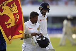 November 7, 2018 - Galle, Sri Lanka - Sri Lankan cricketer Rangana Herath walks back to pavilion following his dismissal during the 2nd day's play of the first test cricket match between Sri Lanka and England at Galle International cricket stadium, Galle, Sri Lanka. 11-07-2018  (Credit Image: © Tharaka Basnayaka/NurPhoto via ZUMA Press)