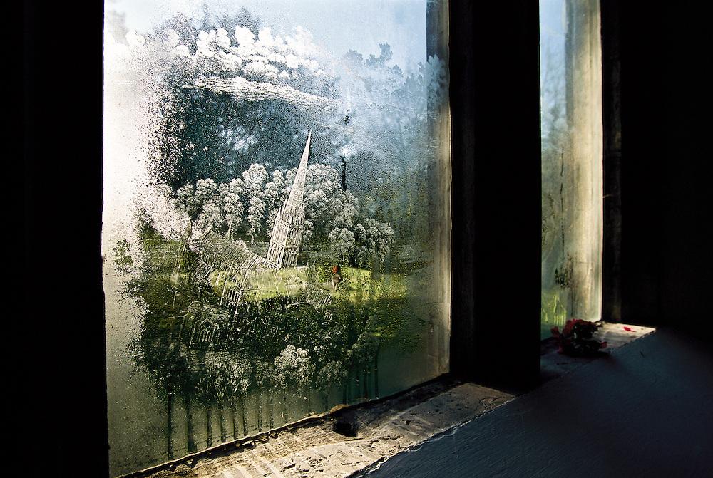 A window depicting British architecture.