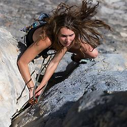 Marina Neilson sport climbing at Moose Mountain in Bragg Creek, Kananaskis, Alberta, Canada