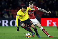 Etienne Capoue of Watford (L) takes on Aden Flint of Bristol City (R). The Emirates FA Cup, 3rd round match, Watford v Bristol City  at Vicarage Road in Watford, London on Saturday 6th January 2018.<br /> pic by Steffan Bowen, Andrew Orchard sports photography.