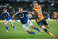 Sam Clucas (Hull City) tries to go past Lee Peltier (Cardiff City) and get a cross into the box during the Sky Bet Championship match between Hull City and Cardiff City at the KC Stadium, Kingston upon Hull, England on 13 January 2016. Photo by Mark P Doherty.