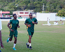 Windward Islands Volcanoes duo of Kevin McClean (left) and Sunil Ambris (right) take a light jog after play against Leeward Islands Hurricanes on the third day of the seventh round match in the WICB Professional Cricket League Regional 4-Day Tournament on Sunday, February 21, 2016 at the Addelita Cancryn Junior High School.© Aisha-Zakiya Boyd