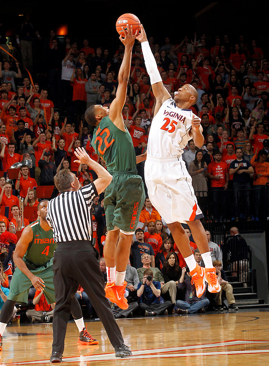 Virginia forward Akil Mitchell (25) reaches for the tip off with Miami forward Donnavan Kirk (22) during an NCAA basketball game Saturday Feb, 24, 2014 in Charlottesville, VA. Virginia defeated Miami 65-40.