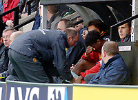 Photo. Glyn Thomas, DIGITALSPORT<br /> Norwich City v Manchester United.<br /> Barclays Premiership. 09/04/2005.<br /> Manchester United's Louis Saha (C) can only hold his head in his hands after he was forced to limp from the pitch with yet another injury after making his return to the team.