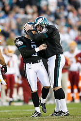 Philadelphia Eagles PK David Akers #2 is congratulated by punter Sav Rocca #6 after Akers kicked the game wining field goal during the NFL game between the Washington Redskins and the Philadelphia Eagles on November 29th 2009. The Eagles won 27-24 at Lincoln Financial Field in Philadelphia, Pennsylvania. (Photo By Brian Garfinkel)