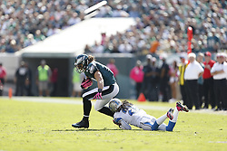 Philadelphia Eagles wide receiver Riley Cooper (14) is tackled during the NFL game between the Detroit Lions and the Philadelphia Eagles on Sunday, October 14th 2012 in Philadelphia. The Lions won 26-23 in Overtime. (Photo by Brian Garfinkel)