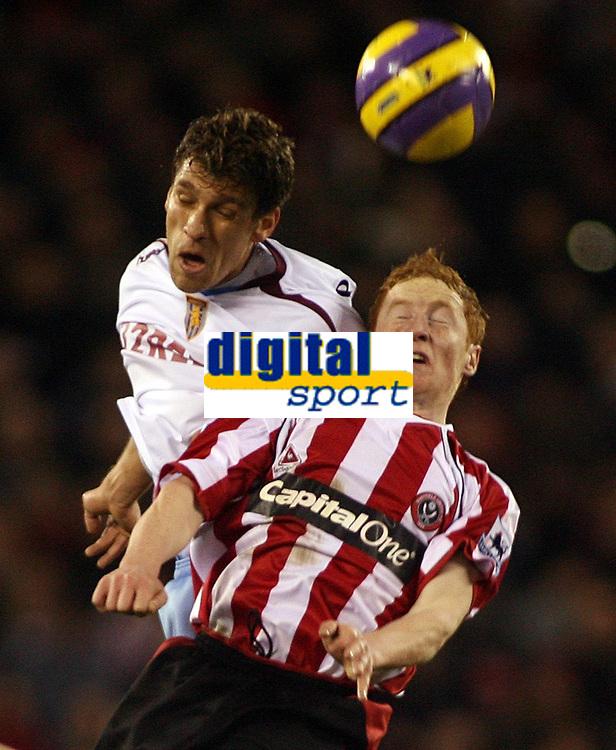 Photo: Paul Thomas.<br /> Sheffield United v Aston Villa. The Barclays Premiership. 11/12/2006.<br /> <br /> Goal scorer Stiliyan Petrov (R) of Villa fights off Stephen Quinn.