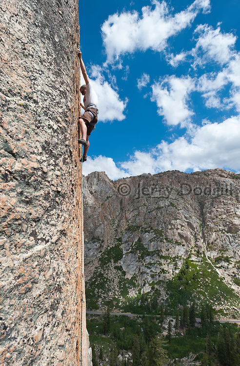 "Eric Berghorn ascending a rock climb called ""Behold the Gold"" 5.10b at Chipmonk Flat on Sonora Pass, Sierra Nevada Mountains, California"