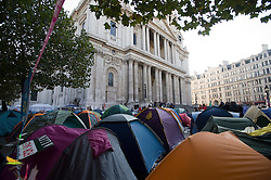 © Licensed to London News Pictures. 22/10/2011. London, UK. Activists tents fill the area in front of St Paul's Cathedral today (22/10/2011). Protestors from 'Occupy London', who are targeting the global financial system as part of a worldwide campaign against corporate greed, have spent their seventh night camped outside St Paul's Cathedral which is adjacent to The London Stock Exchange. Photo credit: Ben Cawthra/LNP