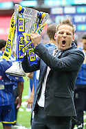 Neal Ardley, the AFC Wimbledon manager  celebrates as he lifts the Sky Bet League 2 Play-off Trophy.Skybet football league two play off final match, AFC Wimbledon v Plymouth Argyle at Wembley Stadium in London on Monday 30th May 2016.<br /> pic by John Patrick Fletcher, Andrew Orchard sports photography.