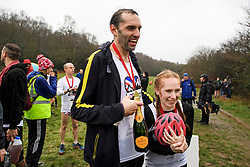 © Licensed to London News Pictures. 03/03/2019. Dorking, UK. Winners of the race CHRIS HEPWORTH and TANISHA PRINCE talk to media after Chris Hepworth proposed to Tanisha Prince at the finish line. Competitors take part in the 2019 annual Wife Carrying Race in Dorking, Surrey. Run over a course of 380m, with both men and women carry a 'wife' over obstacles, the race is believed to have originated in the UK over twelve centuries ago when Viking raiders rampaged into the northeast coast of England carrying off any unwilling local women . Photo credit: Ben Cawthra/LNP