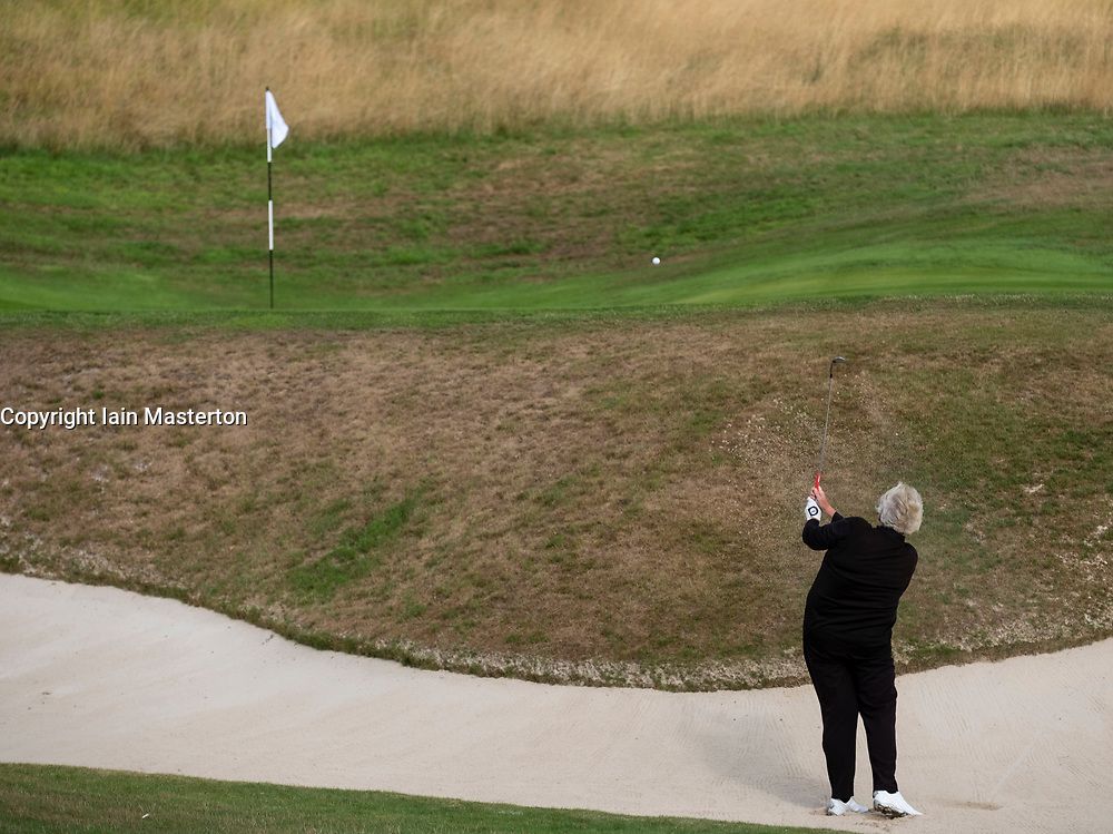 Gleneagles, Scotland, UK; 8 August, 2018.  Day one of golf competition at Gleneagles.. Men's and Women's Team Championships Round Robin Group Stage - 1st Round. Four Ball Match Play format. Gleneagles for the European Championships 2018. Laura Davies of GB plays out of the sand at the 4th hole.