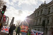 The day after UK Prime Minister Boris Johnson's Conservative Party won a landslide general election victory, winning a majority of 80 parliamentary seats, Brexit Leave campaigners celebrate with Union Jack flags in Whitehall, on 13th December 2019, in Westminster, London, England.